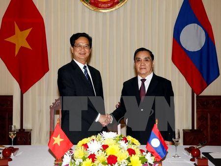 Pho Thu tuong Lao: Viet Nam luon san sang giup do Lao het minh - Anh 1