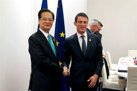 Thu tuong Nguyen Tan Dung hoi dam voi Thu tuong Phap Manuel Valls - Anh 1