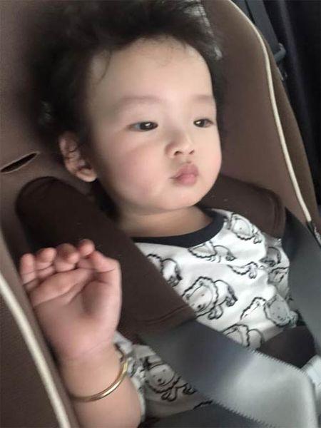 HH Diem Huong cho con trai 1 tuoi di lam toc don Tet - Anh 2