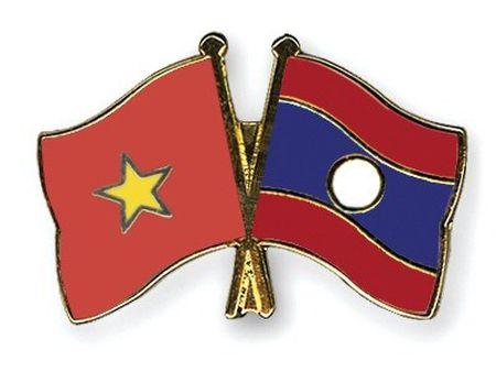 Ke hoach thuc hien Hiep dinh thuong mai Viet Nam va Lao - Anh 1