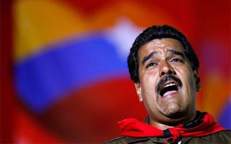 """Venezuela co the phai doi vang lay tien tra no"" - Anh 1"