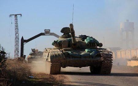 Tan cong o at, quan Assad don ke thu vao chan tuong - Anh 1