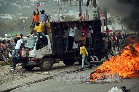 LHQ hoi thuc duy tri on dinh tai Haiti - Anh 1