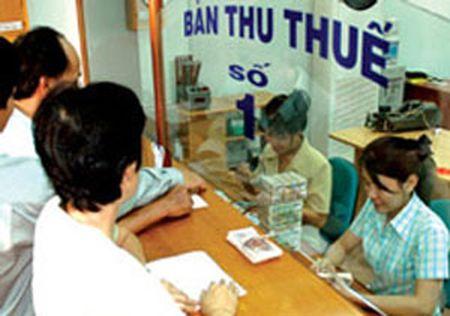 Bo Tai chinh trinh Chinh phu de nghi xoa hon 10.000 ti dong tien no thue - Anh 1