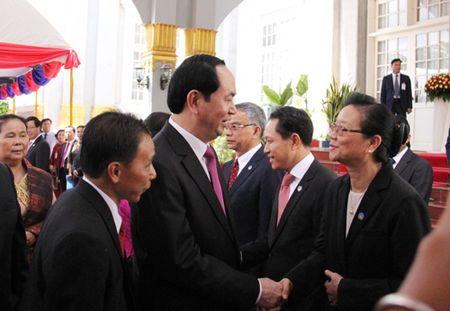 Chu tich nuoc: Viet Nam luon coi trong moi quan he dac biet voi Lao - Anh 2