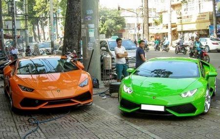 Lamborghini lap ky luc: 2 tieng ban mot sieu xe - Anh 2