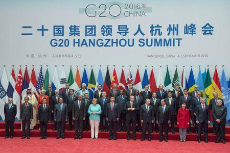 Lanh dao G20: Can phai giai quyet van de bat binh dang thu nhap - Anh 1