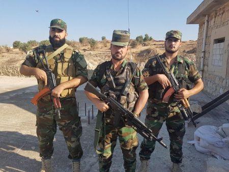 Quan doi Syria, Hezbollah tan cong thi tran Khan Touman (video) - Anh 1