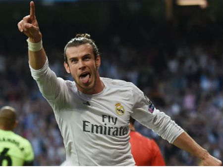 Bale CHINH THUC gan bo voi Real, luong vuot Ronaldo - Anh 1