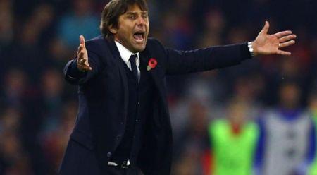 HLV Conte canh bao nguoi ham mo Chelsea cho som voi mung - Anh 1
