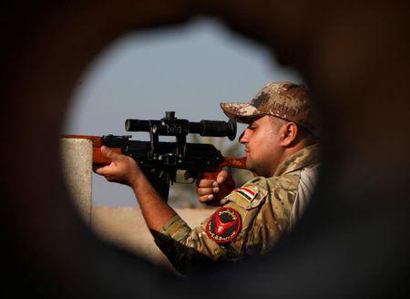Dac nhiem Iraq thua thang xoc toi o thanh pho Mosul - Anh 11