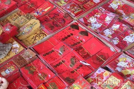 Ngay 22 thang Chap: Nguoi Sai Gon ron rang mua sam Tet tai cho tai loc Hai Thuong Lan Ong - Anh 10