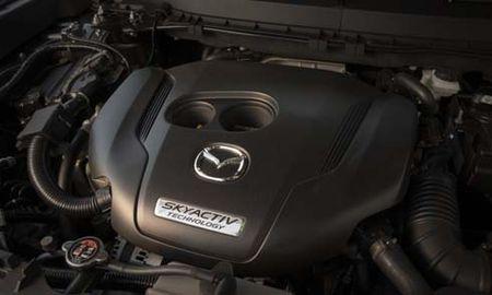 Mazda sap ung dung dong co chay xang khong bu-gi - Anh 1