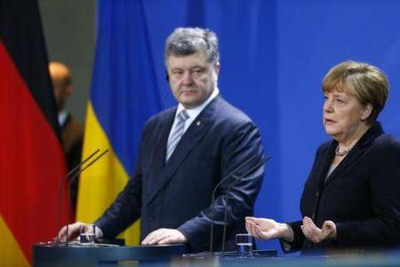 Ong Trump chon ba Merkel de hoi ve Ukraine va Putin - Anh 2