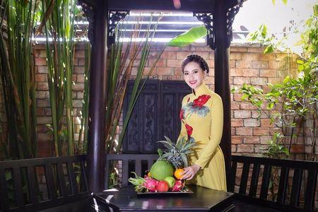 Khanh Ngan diu dang trong ta ao dai 'Hoa sen dat Viet' - Anh 3
