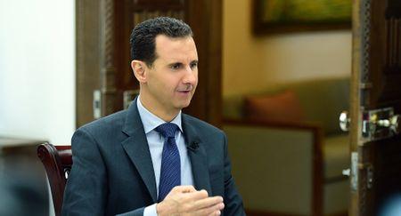 Assad: My lam tat ca de lat do chinh phu Syria, lap 'che do bu nhin' - Anh 1