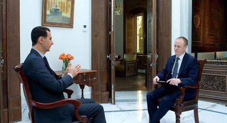 Tong thong Assad: My se lam tat ca de lat do chinh phu Syria - Anh 1