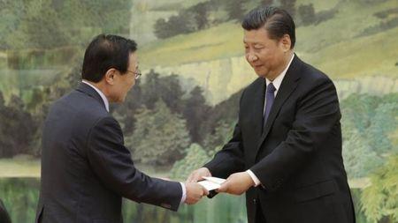 Phai vien Han Quoc tham Bac Kinh, hy vong giam cang thang - Anh 1