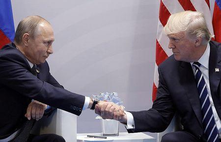 Dang sau nhung loi nhan xet dac biet cua TT Putin ve ong Trump - Anh 1