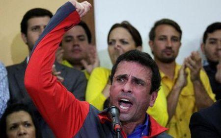 Venezuela: Sat ngay bau cu, phe doi lap tim cach dao chinh quan su - Anh 1