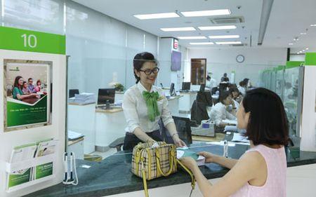 Vietcombank duoc lap ngan hang 100% von tai Lao - Anh 1