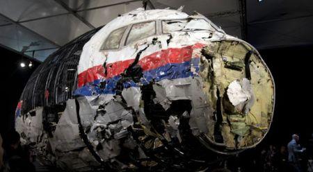 Uc doi xu vang mat nhung ke ban roi may bay MH17 - Anh 1