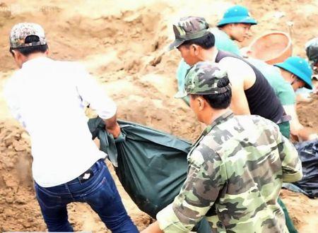 Tim thay 21 hai cot liet si tai chien khu Tam Giac Sat - Anh 2