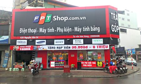 FPT ban 30% co phan tai cong ty quan ly chuoi cua hang FPT Shop - Anh 1