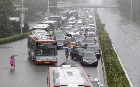 Trung Quoc: Hang tram chuyen bay tai Bac Kinh bi hoan - Anh 1