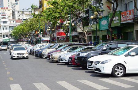 TP HCM: Thu phi dau o to duoi long duong qua dien thoai - Anh 1