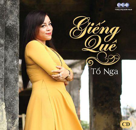 Sau 20 nam ca hat, NSUT To Nga ra mat album 'Gieng Que' dam chat xu nghe - Anh 1