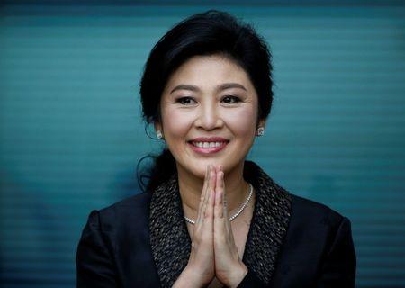 Cuu Thu tuong Thai Lan Yingluck bi truy na, lat lai be boi tham nhung tro gia gao - Anh 1