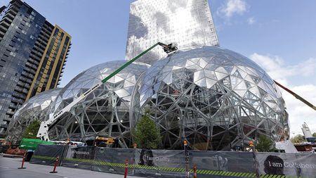 Amazon 'kho tho' tai Seattle, cac thanh pho dua nhau moi goi - Anh 1