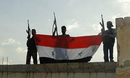 Quan Syria giai phong nhieu khu vuc o mien trung Syria - Anh 1