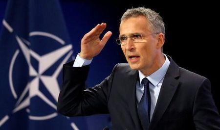 Tong thu ky NATO keu goi 'phan ung toan cau' voi Trieu Tien - Anh 1