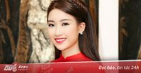 Hoa hậu Đỗ Mỹ Linh diện áo dài đỏ nổi bật cả phố đi bộ