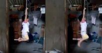 Phẫn nộ trước clip bé gái 4 tuổi bị trói tay, treo trên xà nhà gào khóc thảm thiết
