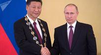 Ông Putin trao phần thưởng Thánh Andrei cho ông Tập