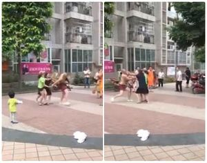 Vợ và bồ nhí hợp lực đánh chồng tơi tả giữa phố