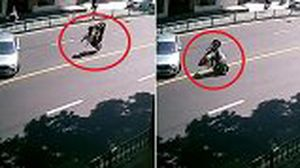 Thanh niên thản nhiên dựng xe máy, nằm ngủ 'quên đời' giữa quốc lộ