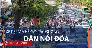 TP Hồ Chí Minh: Dân phản ứng xe dẹp vỉa hè gây ùn tắc giao thông