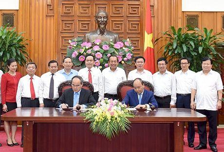 Thu tuong va Chu tich MTTQ ky Nghi quyet lien tich - Anh 1