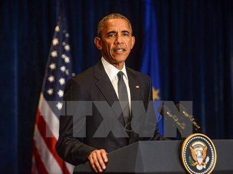 Bau cu My 2016: Tong thong Barack Obama da di bo phieu som - Anh 1
