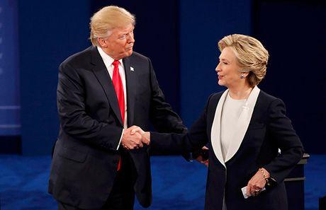 Clinton - Trump bat tay sau yeu cau noi tot ve nhau - Anh 1