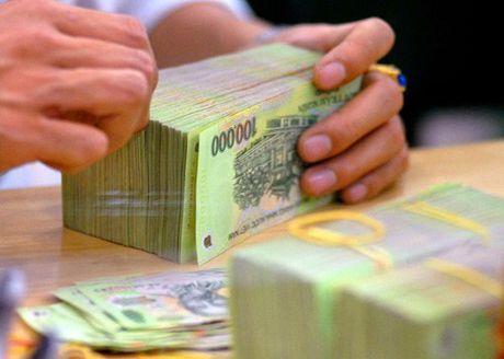 Tong no xau khoang 9,2% GDP - Anh 1