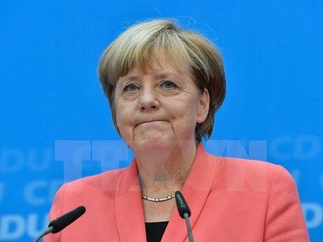 Ty le ung ho dang cua Thu tuong Merkel giam xuong muc ky luc - Anh 1