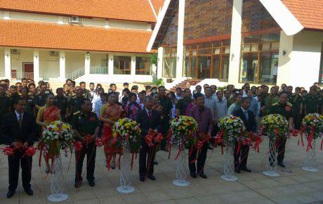 Khai mac Trien lam 'Duong Ho Chi Minh huyen thoai' tren dat Lao - Anh 1