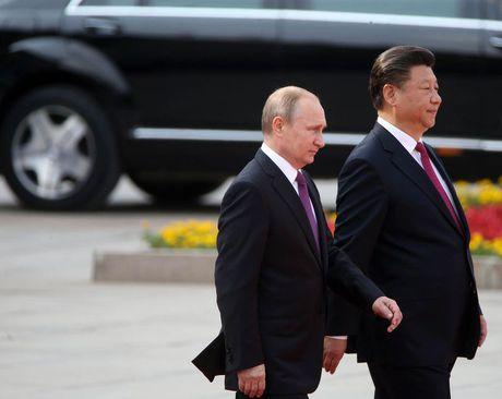 Tap Can Binh va Vladimir Putin: moi tinh huynh de nong duom - Anh 2