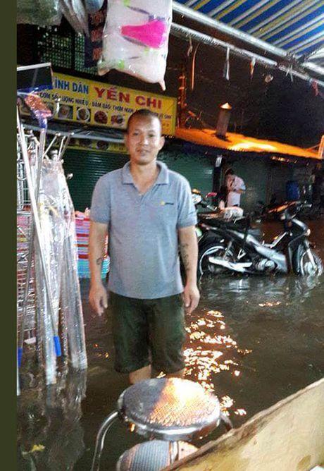 TP Ho Chi Minh lai ngap nang do trieu cuong va mua lon - Anh 16