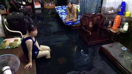 TP Ho Chi Minh lai ngap nang do trieu cuong va mua lon - Anh 7